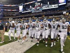 "Spartan linemen lock arms and form ""The phalanx"" during their Cotton Bowl victory."