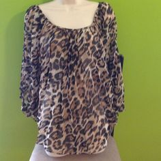 Fredricks of Hollywood cape leopard Flowing blouse but it's a cape style.  Size large Frederick's of Hollywood Tops Blouses