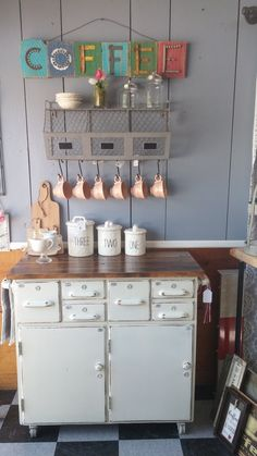 Coffee bars have become a decorative and functional addition to kitchens lately and this is one of only two Richard created with some old school house cabinets and reclaimed wood. The base features Ri