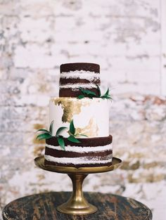 Three tier chocolate and vanilla edible gold wedding cake: http://www.stylemepretty.com/2016/10/04/fall-wedding-trends/ Photography: Diana McGregor - http://www.dianamcgregor.com/