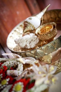 One important tradition is the shell ceremony; after the couple is married a monk or an elder member of the family, each person at the ceremony uses the shell to pour water over the couples' hand as well as offering blessings and well-wishes