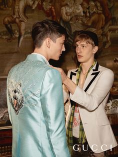 Guys in suits, in the Gucci Cruise 2017 campaign, featuring Alessandro Michele's tailoring with intricate embroideries and trimmed lapel.