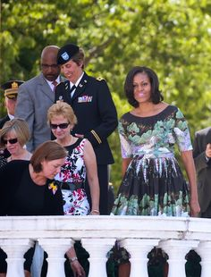 Michelle Obama - Spring dress with 3/4 sleeves and flare pleated skirt. Clever positioning of floral prints against shades of black to accentuate curves.