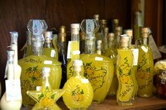 12 Great Limoncello Cocktails: Bottles of limoncello. Sorrento, Campania, Italy, Europe