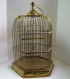 I have a crazy obsessed with vintage birdcages like this, I want one badly with a stand to hang jewelery in!