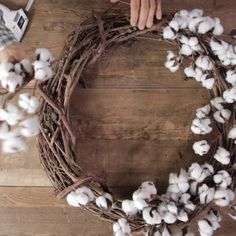 christmas wreaths Add modern farmhouse style to your fall front door with a homemade cotton wreath. Made from a simple grapevine form and store-bought cotton bolls, the natural wreath is both affordable and easy to assemble. Farmhouse Style Decorating, Farmhouse Decor, Modern Farmhouse, Decorating For Spring, Christmas Wreaths, Christmas Crafts, Christmas Decorations, Diy Easter Decorations Home, Easter Crafts