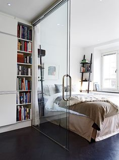 Glass wall divider in a small apartment separating kitchen and bedroom. #small #space #solution