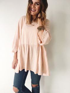 Blush Peplum  Loose Fit  3/4 Sleeve  Gathered Seam at Waist  Also Available in Cranberry + Mustard