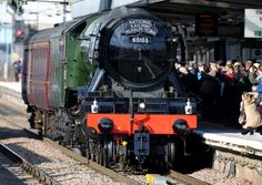 The Flying Scotsman, painted in its traditional colours, passes through Peterborough railway station on its way to London ahead of its inaugural journey from Kings Coss to York later this week. PRESS ASSOCIATION Photo. Picture date Wednesday February 24, 2016. Photo credit should read: Chris Radburn/PA