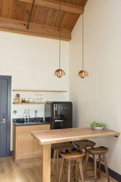 Fridge The Novogratz-Designed Timber Cove Small Apartment Kitchen, Loft Kitchen, Kitchen Interior, Mini Kitchen, Kitchen Decor, Small Kitchens, Small Bathrooms, Kitchen Shelves, Hotel Kitchenette