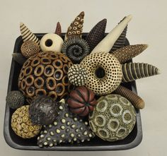 Kelly Jean Ohl  Could be used as decorative small bowl on tabletop (fiddly things) or larger as coffee table decorations