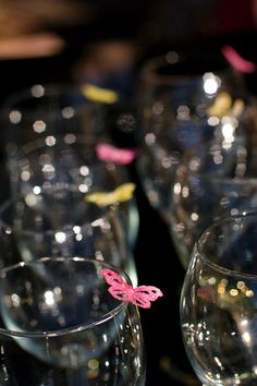 Edible butterflies on the rims of glasses