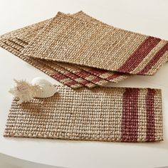 Tennille Woven Placemats | Woven with natural rope, these placemats feature two indigo stripes for visual interest. Set of six.