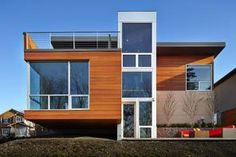The house had to be efficient in size, and it had to take into account how we use energy. The house had to be low-maintenance, Jay says. External materials are clear tongue-and-groove cedar, HardiePanel, aluminum windows and a metal roof.