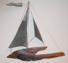Driftwood and vintage metal hanging sailboat. www.rlbrethauer.com. Available on Etsy.