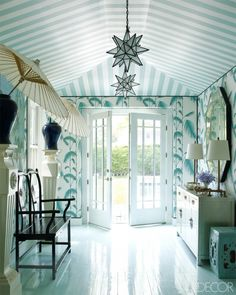 From Elle Decor by Miles Redd, who is not afraid of color or pattern! Southampton home of Erika Bearman. Striped ceiling and leafy wallpaper. Parasols in vases. How island paradise! Home Interior, Interior And Exterior, Interior Decorating, Decorating Ideas, Interior Office, Luxury Interior, Modern Interior, Elle Decor, Striped Ceiling