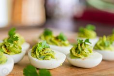 Avocado in eggs tastes surprisingly great and it's a healthier way to make these guacamole stuffed eggs! Everyone at your party will want to give 'em a try.