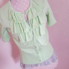 SALE! Mint green cardigan Mint green short sleeve cardigan with ruffles. Pretty and comfortable. Great with jeans or trousers. Color makes it a beautiful statement piece in your wardrobe. Like new condition. Van Heusen Sweaters Cardigans