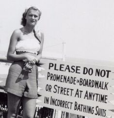 Sign of the Times – 21 Hilarious Vintage Snapshots of People Posing Next to Funny Signs