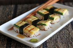 Roasted zucchini as nigiri sushi.  In Italian? but picture is pretty self explanatory