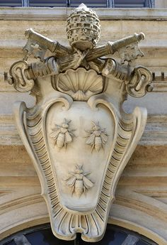 The coat of arms of Pope Urban VIII by Francesco Borromini at Palazzo Barberini in Rome. Palazzo Barberini was built by Gian Lorenzo Bernini with the assistance of Francesco Borromini. Filippo Juvarra attributes to the latter the coat of arms in the façade. Actually the shell appears also on a window which is certainly by Borromini.