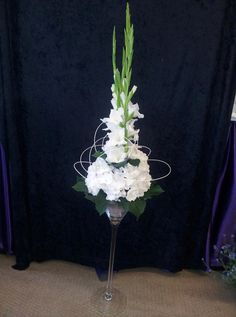 Cocktail vase with a tight group of hydrangeas and tall gladiolus