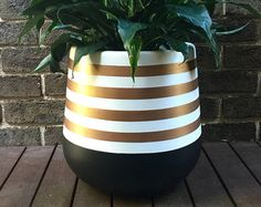 MEDIUM lightweight plant pot hand painted in black and white with rose gold metallic stripes. This is a striking design which will add a touch a glamour to your home! The material of the pot is fibreglass. Size is 35 x As the pots are hand painted Painted Plant Pots, Painted Flower Pots, Indoor Plant Pots, Potted Plants, Indoor Flower Pots, Decoration Plante, Cement Pots, Plant Painting, Large Painting
