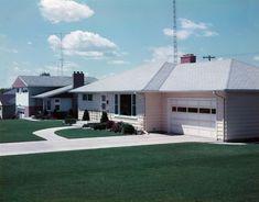 Photograph of a suburban home in Crookston, Minnesota, 1957, by O. Johnson. Via Corbis.