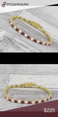 """18KT gold over 925 SS Ruby & Topaz tennis bracelet Stunning!!! 18KT gold over 925 Sterling Silver Ruby & Topaz tennis bracelet 9g.   6.75"""" long 925 Jewelry Bracelets"""