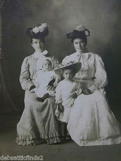 Victorian ladies with their children pose for a photo late 1900.