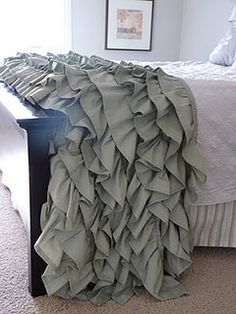 DIY ruffled throw made using two King sized sheets. Pretty!!!!
