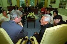 This item is a photograph of President William J. Clinton meeting with Cuban political prisoner Mario Chanes and his family in the Oval Office of the White House. The image was photographed by Barbara Kinney. National Archives Identifier: 2867012
