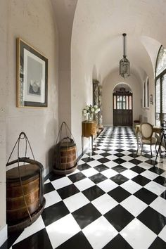 Vintage California home entry hallway, arched barrel ceilings, black and white checkerboard floor (Houzz). Photographer Mark Pinkerton says the home has been used in several movies. Flooring, House Design, Best Flooring, Checkerboard Floor, Home, Checkered Floors, Black And White Decor, Black And White Tiles, Floor Design