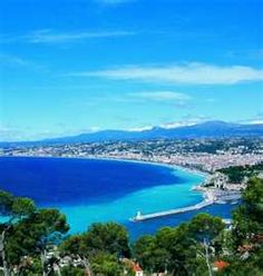 The beach in Nice, France... the water is truly this blue! Ahh, I want to go there my aunt and cousin went all over there in that area.