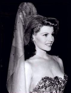 Rita Hayworth candid on the set of You Were Never Lovelier