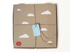 Stick clouds on kraft paper pizza box, and finish with a sky blue tag. Success!