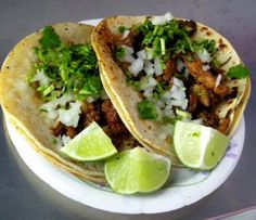 double corn tortillas with onion, cilantro, beef and lime and a red salsa = <3 <3 <3