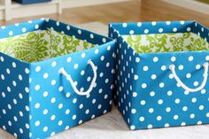 DIY Fabric Covered Boxes - Just did a version of these with some fabric scraps and hot glue.  I forgot to do a lining first so the inside is just plain cardboard but it will go on a high shelf so that doesn't matter much.  Very easy and fun and looks great.  I plan to do several more to set around the house to hide all our little piles in a pretty way.
