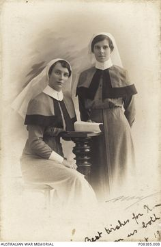Studio portrait of Staff Nurse Mary Agnes (Daisy) Day and friend. The inscription reads 'Best wishes for Xmas from us both'. Nurse Day was a...