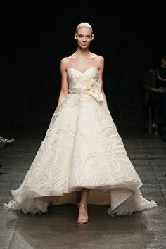 Love the idea of a dress thats shorter in the front, especially for an outdoor wedding-- no tripping over the dress!