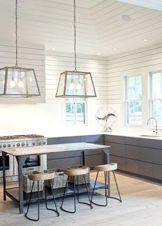 White panelled, gabled ceilings in kitchen.