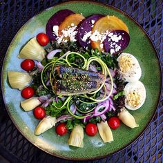 Do salads get any more beautiful than this? #WildPlanet Sardines on a bed of kale, chard, tomatoes, beets, onion, artichoke hearts, feta, egg, seaweed and zucchini noodles.