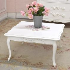"This beautiful coffee table features a square shape with curved corners. It has been painted our famous white and distressed for a lovely, desirable vintage look.  - 31""d x 31""w x 17""t"