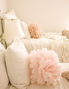 Bed Pom Poms ~ using tulle and same method used for making tissue paper flowers. so cute for a little girls room.