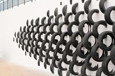 An Artistic Recycled Tire Installation Covers A Wall In Spain