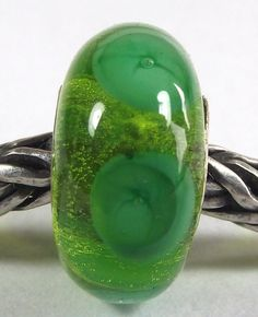 This is a Handmade Authentic Murano Glass Green Bubbles Bead with 18k Gold over solid .925 Sterling Silver whole core  Clear Green background with beautiful green bubbles around around and the gold core make this bead a unique piece of jewelry for your bracelet  Only fits Trollbeads bracelets  *****   I use only Best quality Murano Glass from Italy  SIZE: 14mm x 7mm  INSERT CIRCLE SIZE: 4.mm