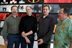 JANUARY 24,  2006: Walt Disney announces the $7.4 billion purchase of Pixar.  Pictured: Walt Disney Co. CEO Robert Iger (center right) smiles with Pixar Animation Studios Inc. CEO Steve Jobs (center left), at Pixar headquarters in Emeryville, California after Disney announces its purchase of longtime partner Pixar.