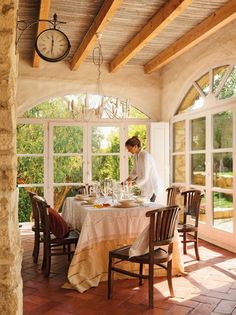 The light-filled dining room has beautiful views into the garden.