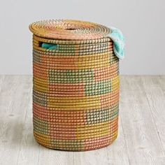 A handmade multi-color woven hamper is the natural way to contain your family's collection of handmade laundry.  A removable lid keeps the mess hidden until you're ready for the wash.  And the handwoven construction means no two hampers will be exactly alike.  Hamper liners sold separately. Nod exclusiveNatural base with multi color woven detailsHamper has fully removable lid with top cutouts for easy on and off.