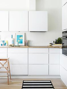 An open-plan kitchen with neutral finishes creates a sense of space and fluidity. Photo: Krista Keltanen | Story: real living